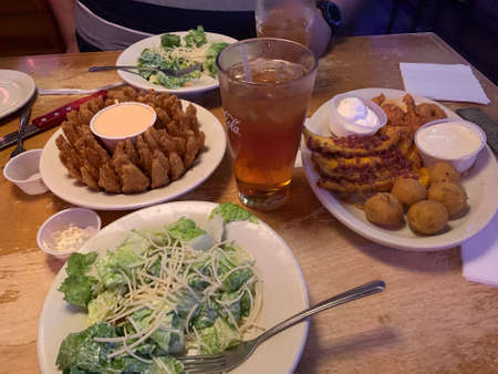 Blooming Onion with salad and sides