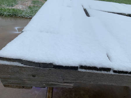 snow covered wood boards