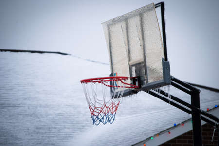 outdoor basketball hopp covered in ice