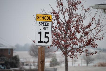 School speed limit sign in winter