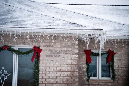 Pine garland and ice over windows