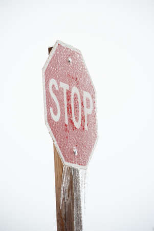 Stop sign covered in ice in winter Stockfoto