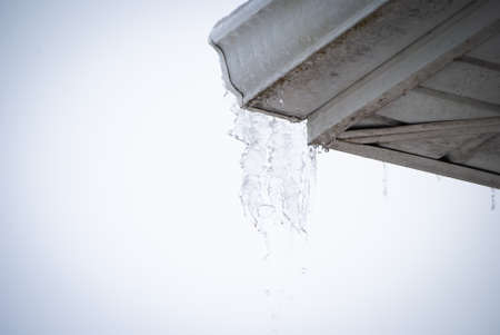 icicles melting from rooftop