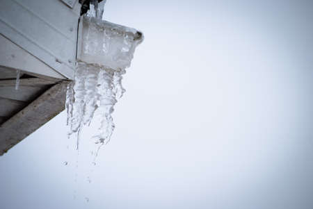 icicles dripping from rooftop