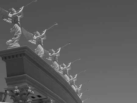 Beatuiful Black and White photo of the angels ontop of Ceaser's Palace in Las Vegas.