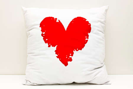 Red heart on a white Pillow Stock Photo - 9686206