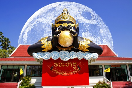 The Rahu Statue and The Big Moon is back side Stock Photo