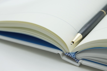 a pen in middle a book