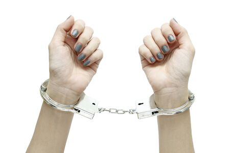 tightly: Woman hands with handcuffs top view