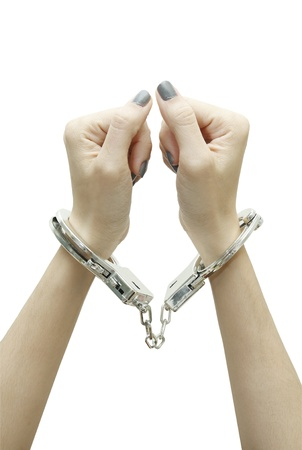 Woman hands with handcuffs top view photo