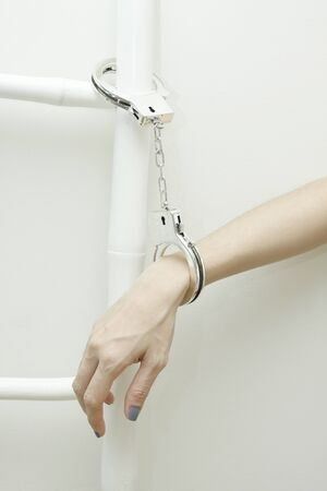 Handcuffed with ladder Stock Photo