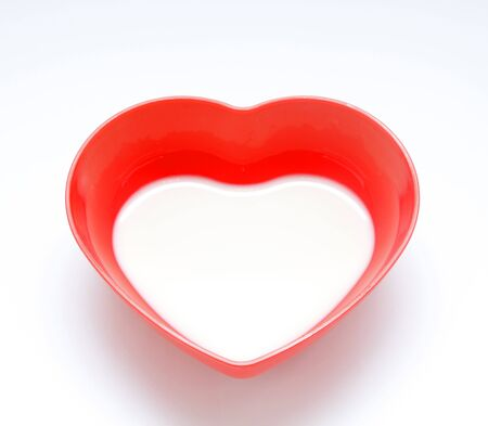 Milk in red cup heart shaped