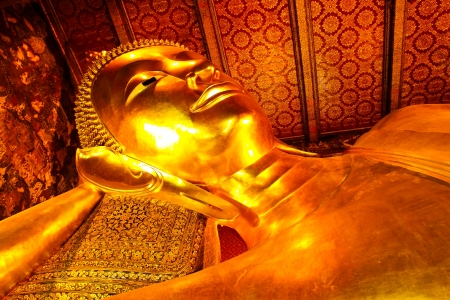 The Big golden Reclining Buddha within Wat Pho also named wat po, wat phra chetuphon or Grand Palace  is the important in Bangkok, Thailand  photo