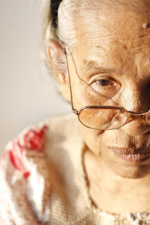 Close up portrait of a sad older woman