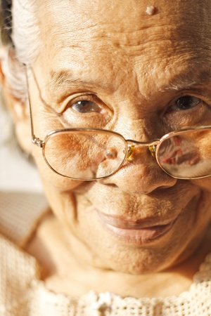 Close up of smiling Elderly Asian Woman Stock Photo