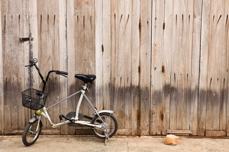 little bicycle with wood door photo