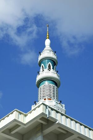 Image of Minaret of the mosque in Thailand with blue sky and cloud  photo
