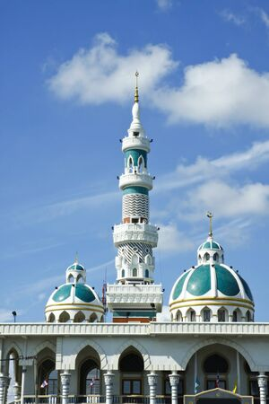 Minaret and dome of the mosque in Thailand with blue sky and cloud