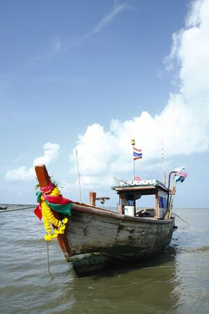 Thai Fishing Boat in blue sky,Thailand,Asia. photo