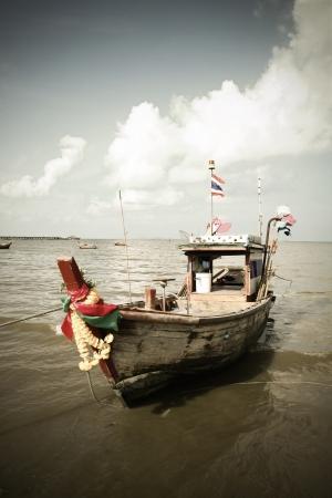 Thai Fishing Boat in blue sky,Thailand,Asia.retro style photo