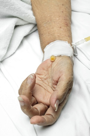 Image of Patient hand with an intravenous drip  photo