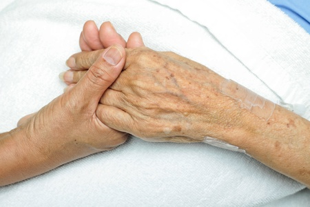 elderly patient: image of Woman ComfortingHand with her mother