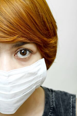 close-up woman wearing protective mask photo