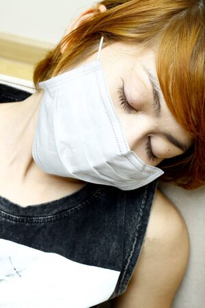 influenza: close-up woman sleep and wearing protective mask Stock Photo