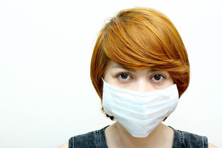 Image of woman wearing protective mask. photo