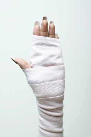 left hand and wrist in thick bandages. photo