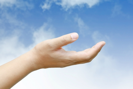 Male hand held up with blue sky and cloud. Stock Photo - 15483044