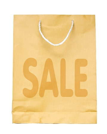 Brown paper shopping bag with Sale isolated on white background. photo