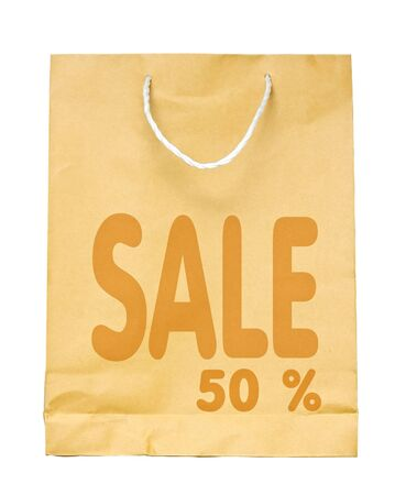 Brown paper shopping bag with Sale 50 % text isolated on white background.