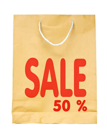 Brown paper shopping bag with Red Sale 50 %  text isolated on white background. photo