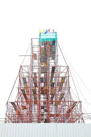 Temporary scaffold for construction works at building site.