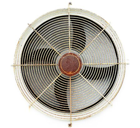 Old fan air compressor with frame on white wall