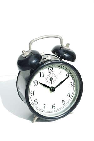 Vintage Alarm clock on white background. Stock Photo