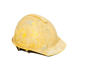 Dirty yellow hard hat on white background.
