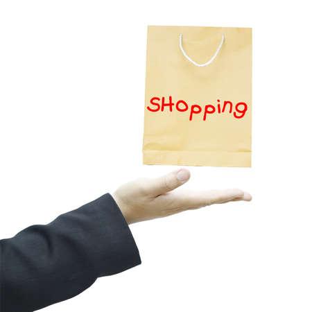 Shopping bag on businessman hand isolated on white background Stock Photo - 16509186