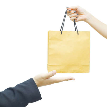 Female keep a brown paper  bag for businessman hand