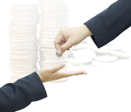 Businessman hand giving a coin for investment to another person on white background Stock Photo - 16509191