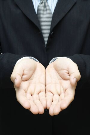 Business man in suit with giving hands. Stock Photo - 16924903