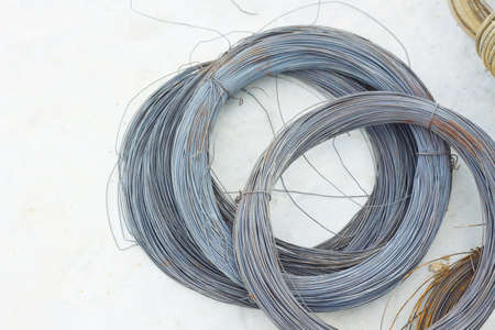 solid wire: Metal wire in a roll on floor