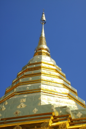 The golden pagoda with blue sky at Wat Phra That Doi Suthep, Temple Chiang Mai Province north Thail. Wat Phra That Doi Suthep contains the Holy Buddha Relic