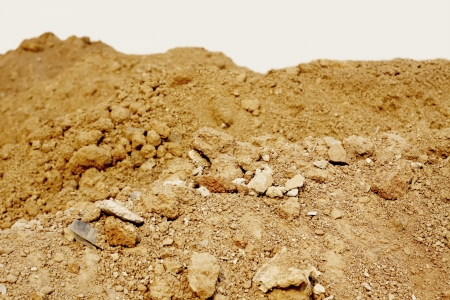 Pile of dry soil at construction site