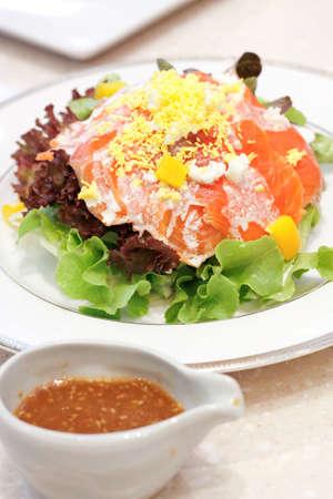 Image of Smoke salmon salad on white dish