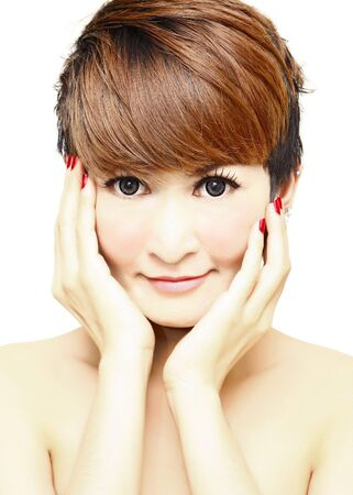 Pretty women short hair touching her Face and smiling.