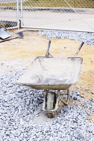 Image of Old wheelbarrow at construction site Stock Photo