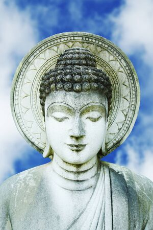 Stone Statue of Buddha with blue sky Stock Photo