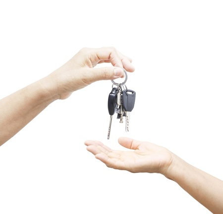 A hand giving a car keys  to another hand photo